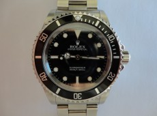 14060M Rolex Submariner overhaul and insurance valuation Photo