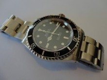 14060M Rolex Submariner overhaul and insurance valuation